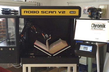 Automated book scanner with robolink D articulated arm